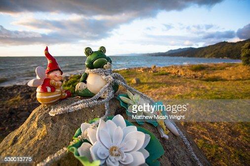 Toys left on a roadside rock in memorial