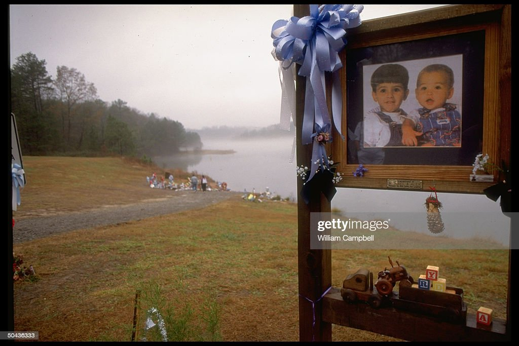 Toys pics of Michael Alex Smith at John D Long Lake shore shrine site of drowning murder of 2 boys by their mom Susan Smith