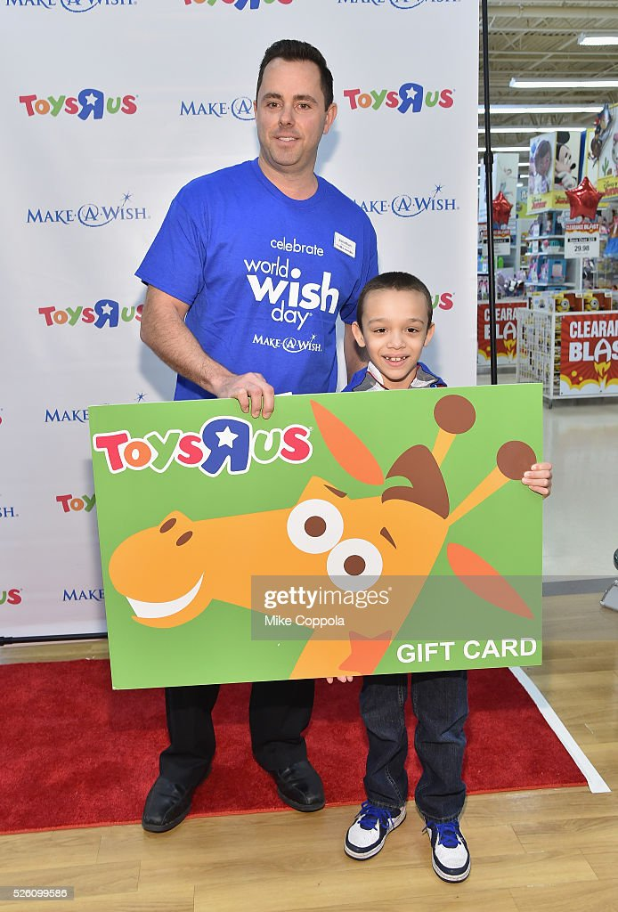 ToysRUs presents Wish Kid Jeiden with a special gift card as part of the retailers World Wish Day celebration at a ToysRUs on World Wish Day at a ToysRUs on April 29, 2016 in Secaucus, New Jersey.
