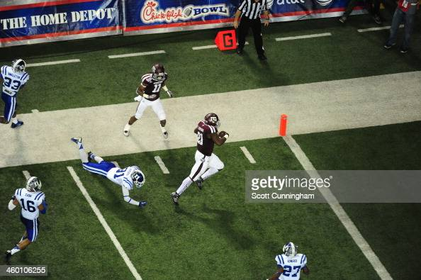 Tra Carson of the Texas AM Aggies scores a second half touchdown against the Duke Blue Devils during the ChickFilA Bowl at the Georgia Dome on...