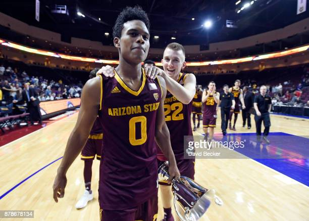 Tra Holder of the Arizona State Sun Devils is congratulated by his teammate Austin Witherill after being awarded the tournament most valuable player...