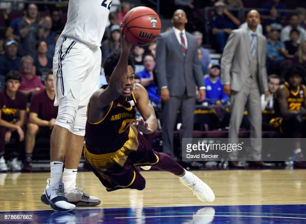 Tra Holder of the Arizona State Sun Devils makes a diving pass against the Xavier Musketeers during the championship game of the 2017 Continental...