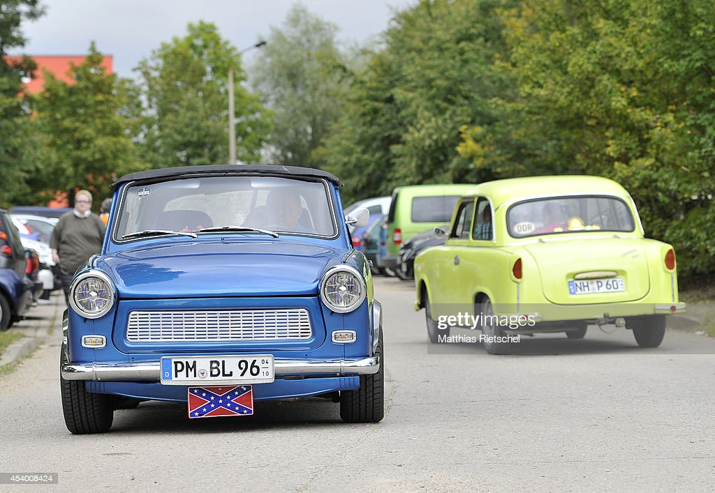 A Trabant 601 car, left, and Trabant 501 car, right, drive through the event terrain as fans of the East German Trabant car gather for their 7th annual get-together on August 23, 2014 in Zwickau, Germany. Hundreds of Trabant enthusiasts arrived to spend the weekend admiring each others cars, trading stories and enjoying activities. The Trabant, dinky and small by modern standards, was the iconic car produced in former communist East Germany and today has a strong cult following.