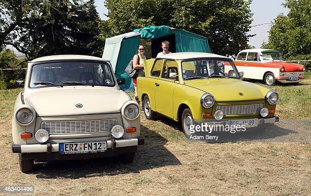 Trabant automobiles are seen at a Trabant enthusiasts' weekend on August 8 2015 near Nossen Germany The Trabant also called the Trabi is the iconic...
