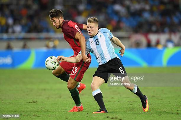 Trabulo Pite of Portugal and Santiago Ascacibar of Argentina compete for the ball during the Men's Group D first round match between Portugal and...