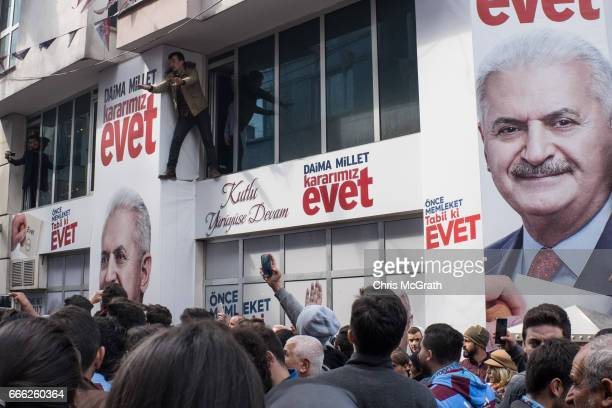 Trabzonspor soccer fans sing and cheer ahead of the days match outside an 'EVET' campaign building on April 8 2017 in Trabzon Turkey Campaigning by...
