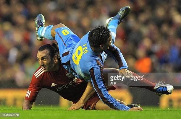 Trabzonspor's Colombian forward Teófilo Gutiérrez vies with Liverpool's Greek defender Sotirios Kyrgiakos during their UEFA Europa League PlayOff...