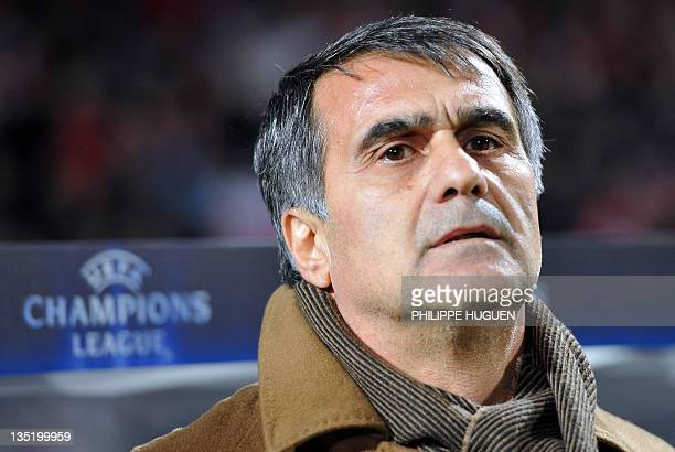 Trabzonspor's head coach Senol Gunes looks at his players during the UEFA Champions League Group B football match Lille vs Trabzonspor AS on December...