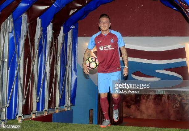Trabzonspor's new transfer Slovakian footballer Juraj Kucka enters the pitch with Trabzonspor's jersey for the first time after a signing ceremony...