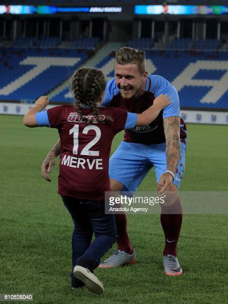 Trabzonspor's new transfer Slovakian footballer Juraj Kucka hugs with a fan named Merve who is a leukemia patient with Trabzonspor's jersey for the...