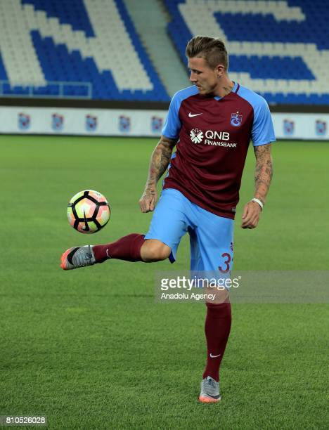 Trabzonspor's new transfer Slovakian footballer Juraj Kucka performs with Trabzonspor's jersey for the first time after a signing ceremony held at...