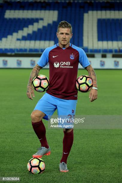 Trabzonspor's new transfer Slovakian footballer Juraj Kucka poses for a photo with Trabzonspor's jersey for the first time after a signing ceremony...