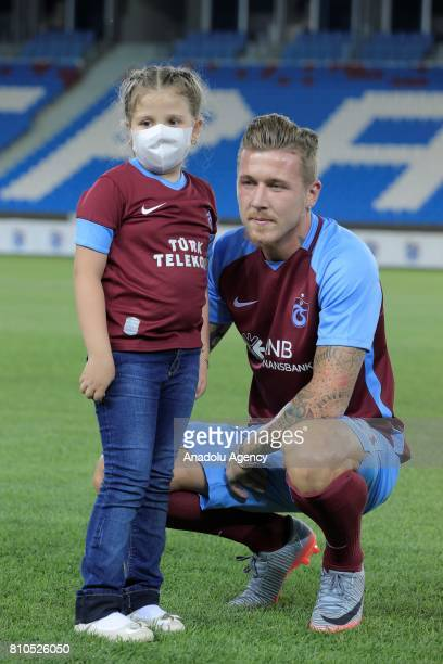 Trabzonspor's new transfer Slovakian footballer Juraj Kucka poses for a photo with a fan named Merve who is a leukemia patient with Trabzonspor's...