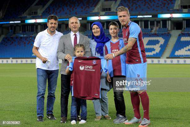 Trabzonspor's new transfer Slovakian footballer Juraj Kucka poses for a family photo with President of Trabzonspor Muharrem Usta a fan named Merve...