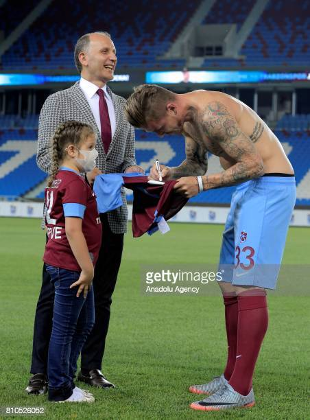 Trabzonspor's new transfer Slovakian footballer Juraj Kucka signs an autograph on a jersey he gifts to a fan named Merve who is a leukemia patient...