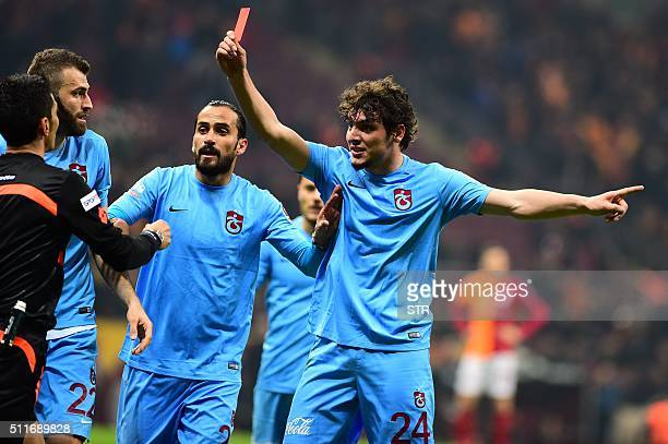 Trabzonspor's player Salih Dursun shows a red card to referee Deniz Ates Bitnel during Turkish Super Lig football match between Galatasaray and...