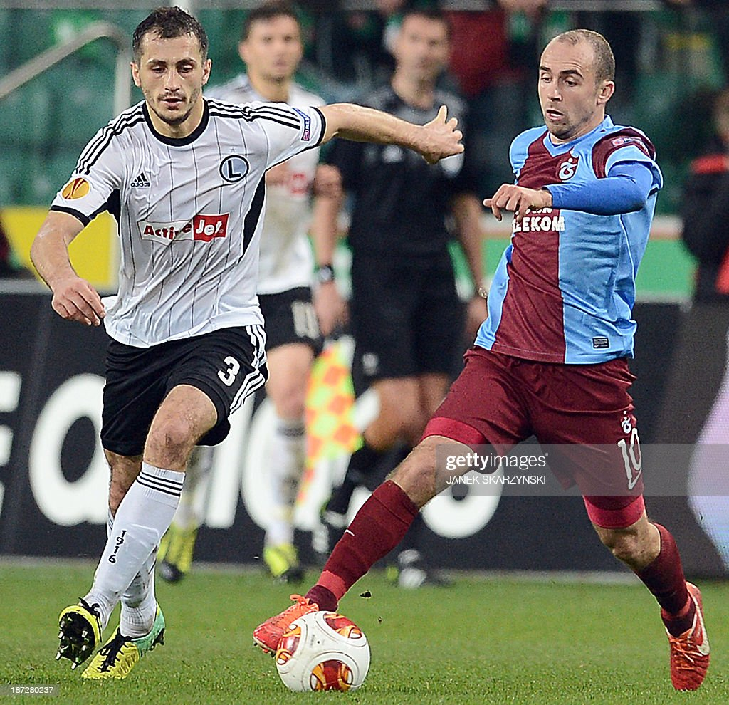 Trabzonspor's Polish midfielder Adrian Mierzejewski and Legia Warsaw's Polish defender Tomasz Jodlowiec vie for the ball during the UEFA Europa...