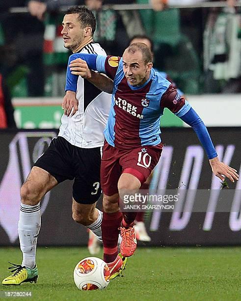 Trabzonspor's Polish midfielder Adrian Mierzejewski and Legia Warsaw's Polish defender Tomasz Jodlowiec vie for the ball during the UEFA Europa...