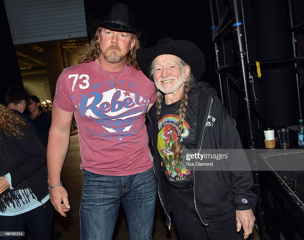 Trace Adkins and Willie Nelson backstage during Keith Urban's Fourth annual We're All For The Hall benefit concert at Bridgestone Arena on April 16, 2013 in Nashville, Tennessee.