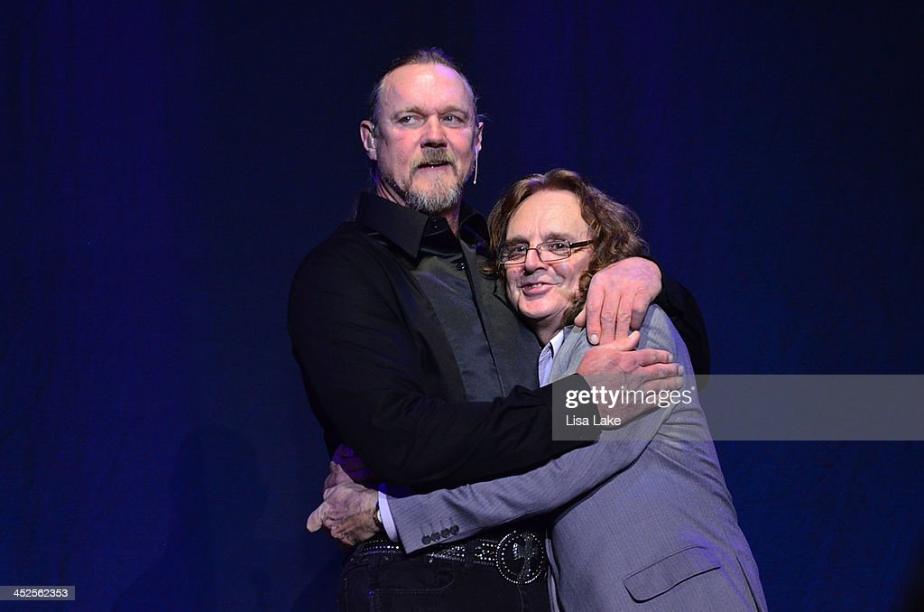 <a gi-track='captionPersonalityLinkClicked' href=/galleries/search?phrase=Trace+Adkins&family=editorial&specificpeople=224686 ng-click='$event.stopPropagation()'>Trace Adkins</a> introduces guitarist Michael Spriggs on stage during 'The Christmas Show' Tour. A night of narration, history and soul-stirring Celtic at Sands Bethlehem Event Center on November 29, 2013 in Bethlehem, Pennsylvania.