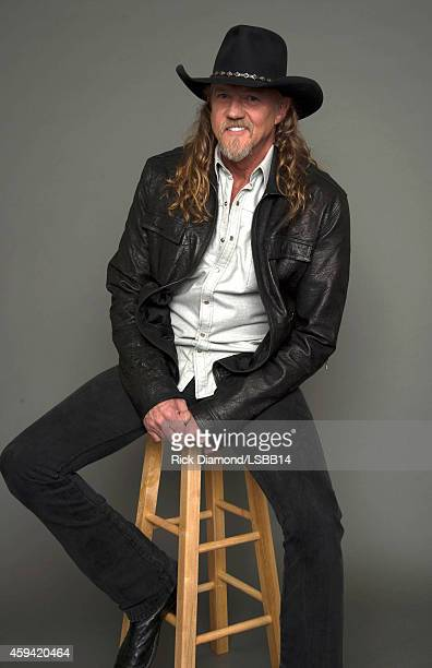 Trace Adkins poses backstage at One More For The Fans Celebrating the Songs Music of Lynyrd Skynyrd at The Fox Theatre on November 12 2014 in Atlanta...