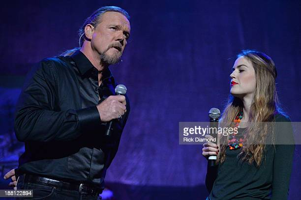 Trace Adkins with Lily Costner during the 'The Christmas Show' Tour A night of narration history and soulstirring Celtic carols on November 14 2013...