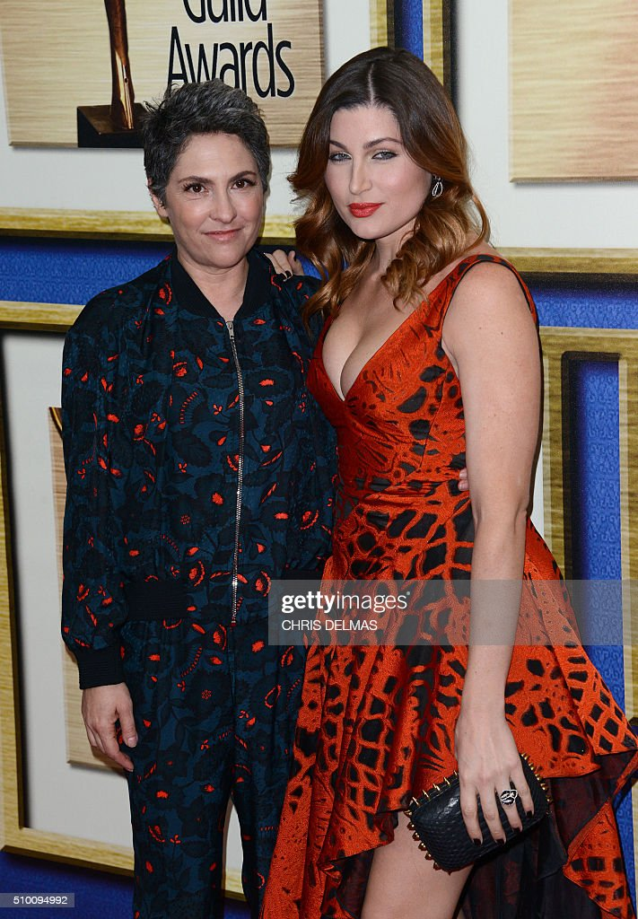 Trace Lysette and Jill Soloway arrives at the Writers Guild Awards, in Century City, California, February 13, 2016. / AFP / CHRIS DELMAS