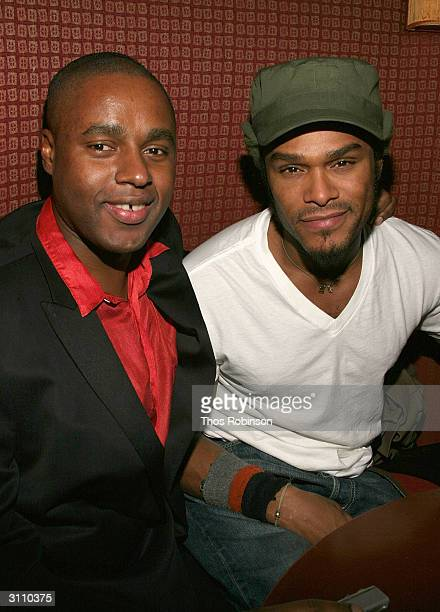 Trace Magazine EditorinChief Claude Grunitzky and singer Maxwell attend the book launch of 'Transculturalism' on March 18 2004 at Diane Von...