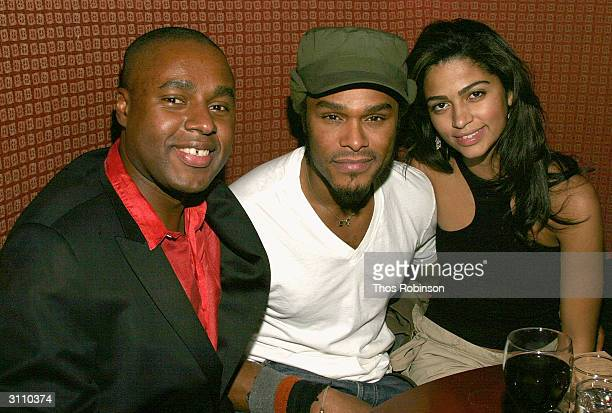 Trace Magazine EditorinChief Claude Grunitzky singer Maxwell and his girlfriend Camilla Alvaz attend the book launch of 'Transculturalism' on March...
