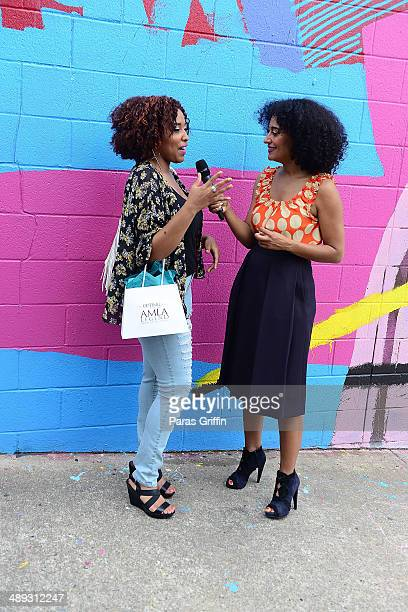 Tracee Ellis Ross interviews attendee about street and hair style at the Legendary Style Soiree at Westside Cultural Arts Center on May 10 2014 in...