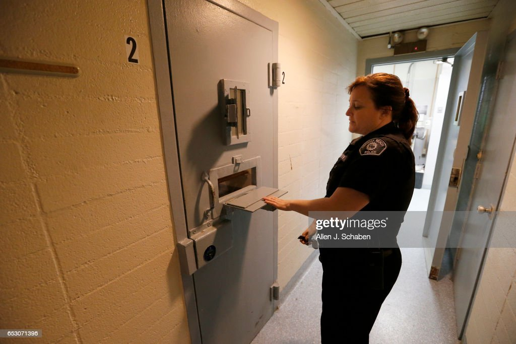 Tracey Carter, lead police service officer, opens a jail cell door with a skeleton key in the Hermosa Beach Police station jail. Hermosa Beach pay-to-stay jail ranks as the priciest of Southern California's pay per night jail cells at $251 a night. Hermosa is one of 26 pay to stay jail facilities around Southern California. A joint project by The Times and the Marshall Project reviewed 3500 defendants who paid to stay between 2011-2015 and found many convicted of violent and sexual crimes. Photo taken Tuesday, Nov. 29, 2016.