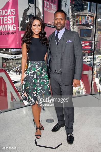 Tracey Edmonds and AJ Calloway pose on the set of 'Extra' at their New York studios at HM in Times Square on September 15 2015 in New York City