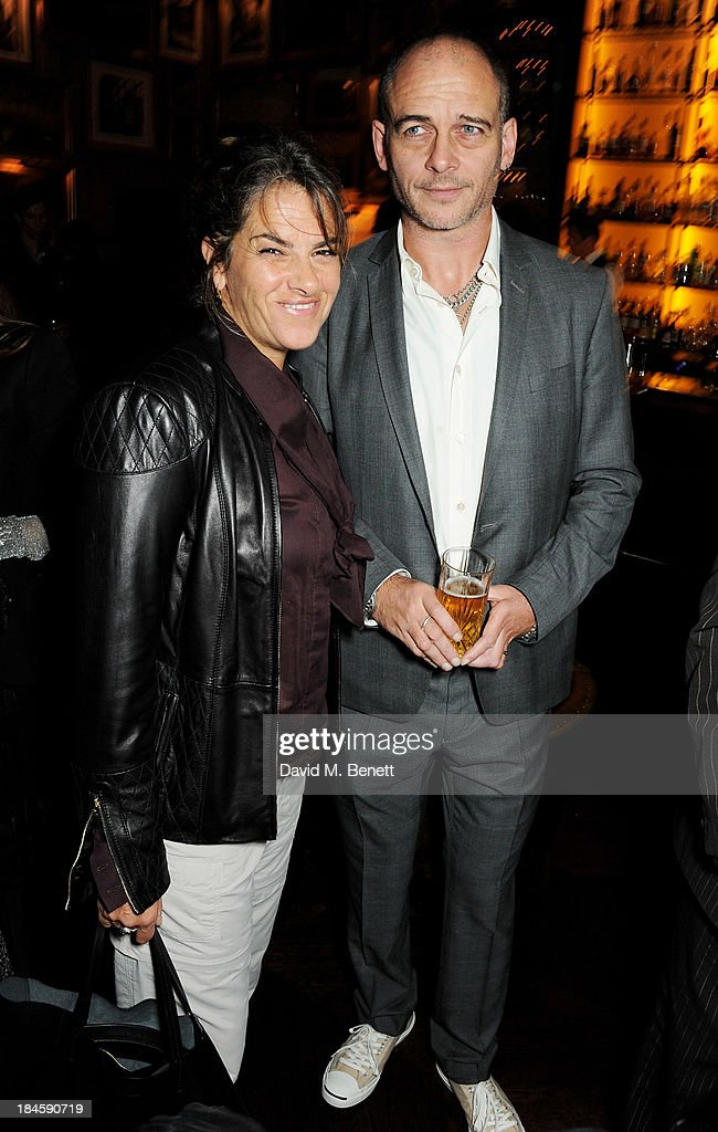 Tracey Emin (L) and Dinos Chapman attend the London EDITION and NOWNESS dinner to celebrate ON COLLABORATION on October 14, 2013 in London, England.