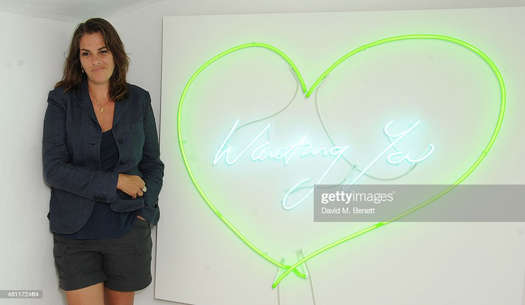<a gi-track='captionPersonalityLinkClicked' href=/galleries/search?phrase=Tracey+Emin&family=editorial&specificpeople=203219 ng-click='$event.stopPropagation()'>Tracey Emin</a> attends a private view of 'Illuminating The Future: In Aid Of The Old Vic', a Christie's online auction benefiting The Old Vic Theatre Trust, at their 35 Brewer Street pop-up gallery on June 24, 2014 in London, England.