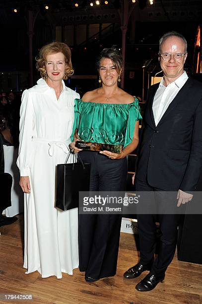 Tracey Emin winner of the Serpentine Gallery GQ Art award poses with Julia PeytonJones and HansUlrich Obrist at the GQ Men of the Year awards at The...