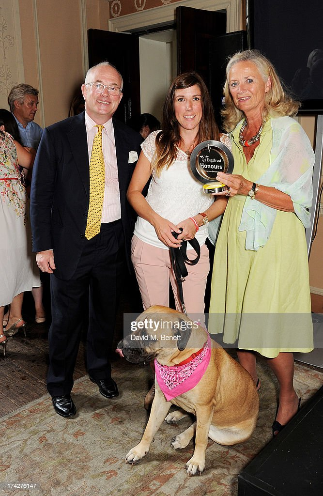 Tracey Marshall (C), owner of Dogged Devotion winner Daisy, poses with Dogs Trust Chairman Philip Daubeny and Dogs Trust CEO Clarissa Baldwin at the Dogs Trust Honours held at Home House on July 23, 2013 in London, England.