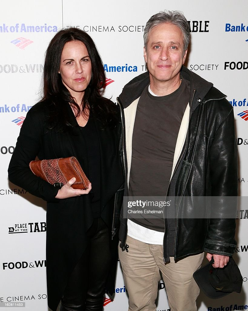Tracey McShane and husband <a gi-track='captionPersonalityLinkClicked' href=/galleries/search?phrase=Jon+Stewart+-+Political+Satirist&family=editorial&specificpeople=202151 ng-click='$event.stopPropagation()'>Jon Stewart</a> arrives at Bank of America and Food & Wine with The Cinema Society present a screening of 'A Place at the Table' at the Celeste Bartos Theater at the Museum of Modern Art on February 27, 2013 in New York City.