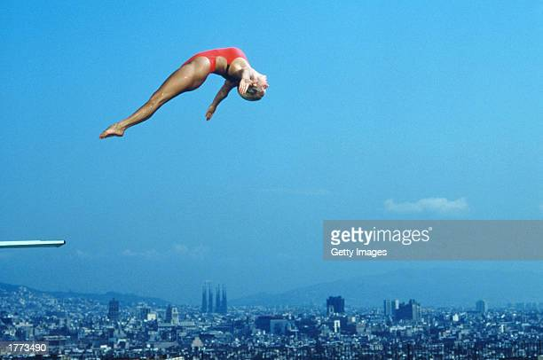 Tracey Miles of Great Britain is captured high over the Sagrada Familia during a diving competition prior to the Barcelona Olympics of 1992