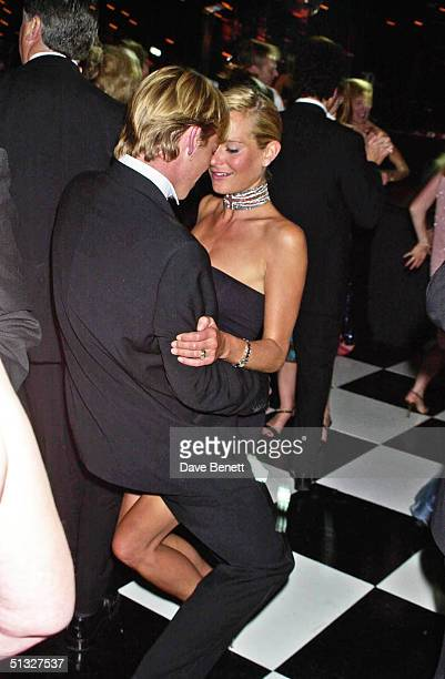 Tracey Shaw and her husband attend the 2001 Grand Prix Ball at Stowe School on July 14 2001 in London