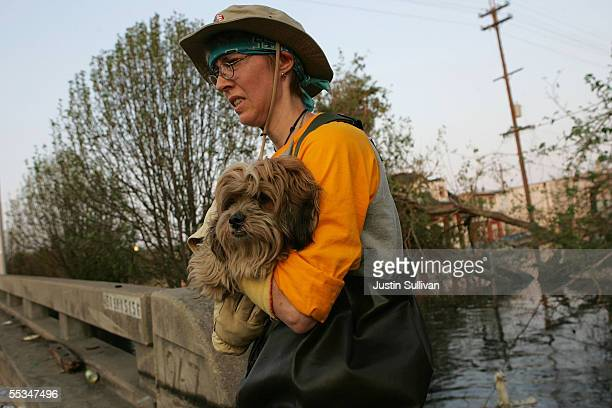 Tracey Simmons carries a dog that was rescued from a home near the French Quarter September 10 2005 in New Orleans Louisiana Volunteers have found...