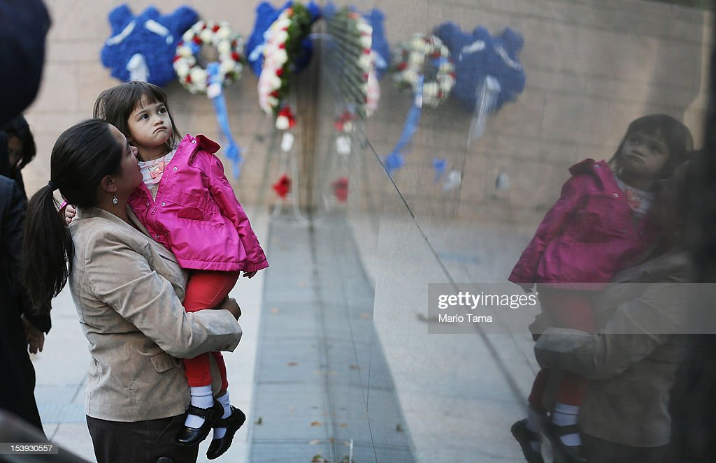 Tracey Wagner (L) and Jillian Wagner (R), the sister and niece of deceased NYPD officer Alain K. Schaberger, look on during an unveiling ceremony at the New York City Police Memorial Wall on October 11, 2012 in New York City. The city unveiled the names of fiften officers who died last year.Thirteen succumbed to illnesses as a result of September 11 and two died from violence in Brooklyn, including Schaberger, who was shoved off a balcony.