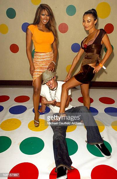 Traci Bingham and Bai Ling dominate Eric Balfour in a game of Twister