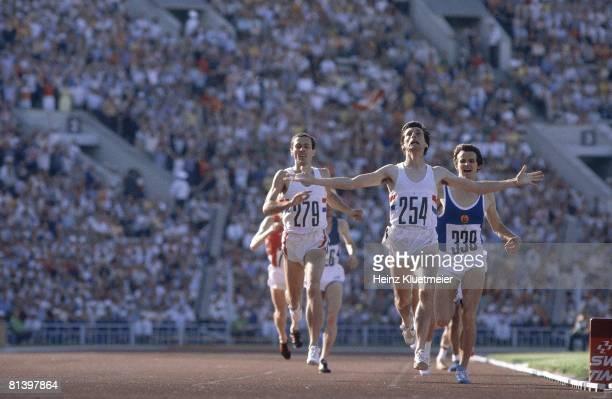 Track 1980 Summer Olympics GBR Sebastian Coe victorious after 1500M race vs GDR Jurgen Straub and GBR Steven Ovett Moscow USR 7/19/19808/3/1980