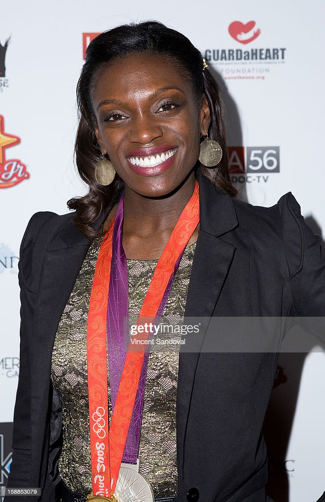 Track and field athlete and Olympic gold medalist Dawn Harper attends the 'First Night 2013' New Year's Eve Party hosted by Jamie Kennnedy at Grauman's Chinese Theatre on December 31, 2012 in Hollywood, California.