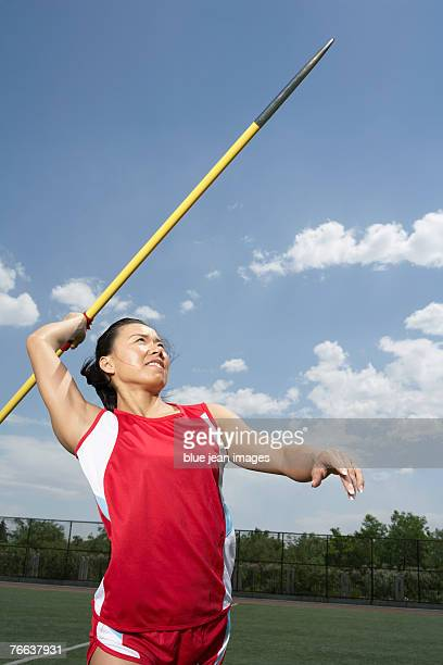 A track and field athlete is throwing the javelin.