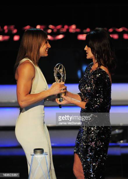 Track and field athlete Jessica Ennis receives her award for 'Laureus Sportswomen of the Year' from Laureus Academy Member Nadia Comaneci on stage...