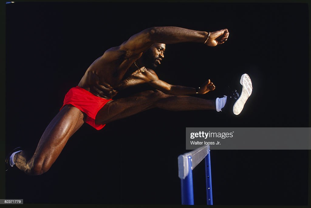 Portrait of Edwin Moses jumping hurdle in Irvine, CA. PUBLISHED