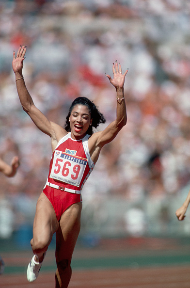track-and-field-runner-florence-griffith-joyner-celebrates-as-she-picture-id576625422?k=6&m=576625422&s=594x594&w=0&h=ZjRdAUpjm9I3oH6uZaZm4Erhuaj2nU9fiL6znl3JZlM=