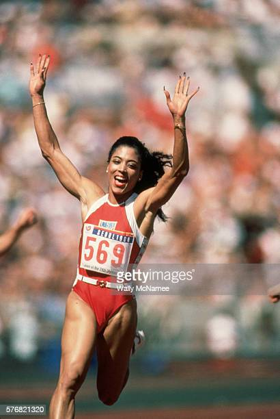 Track and field runner Florence Griffith Joyner waves to the sky as she wins the 100 meter dash at the 1988 Olympics in Seoul Korea