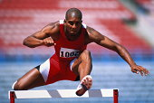 Track and Field, runner jumping over hurdle